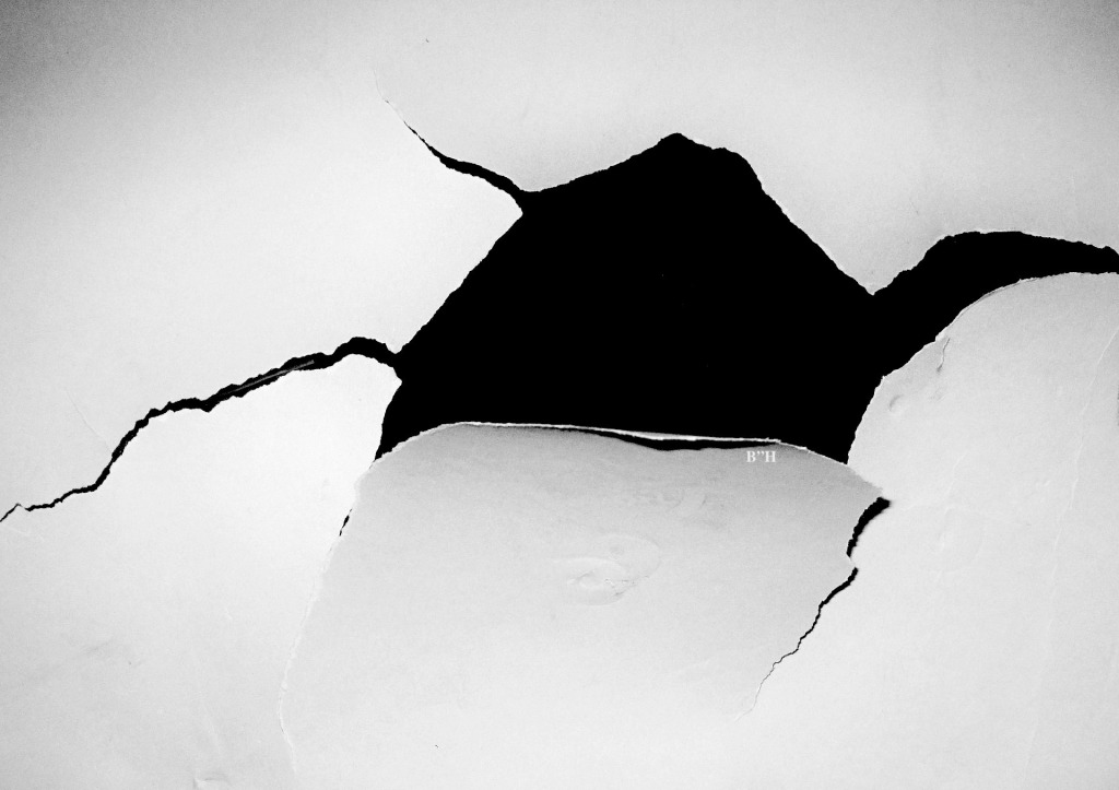 ripped hole in paper