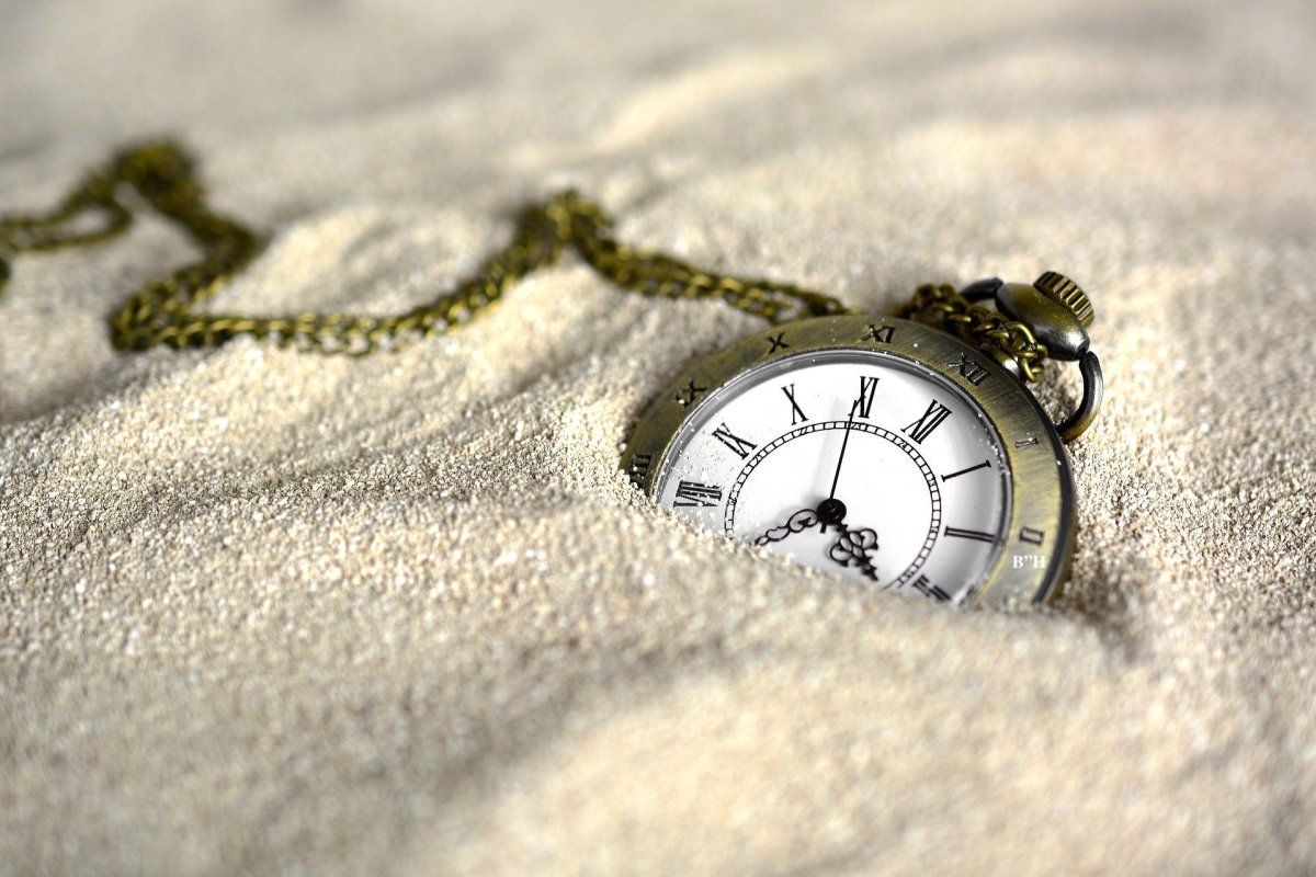 pocket watch in the sand